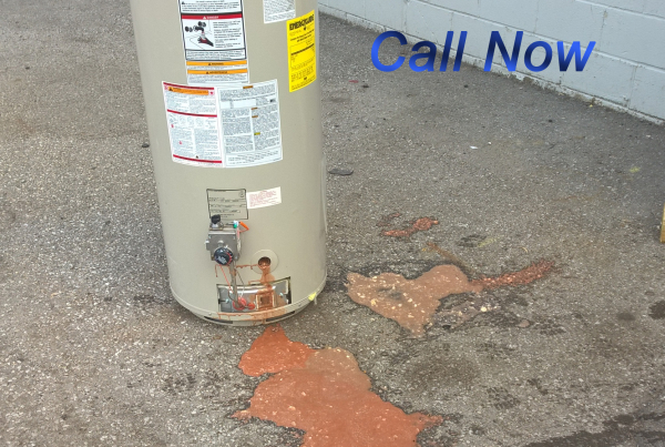Red Corrosion leaking out of hot water tank, make the switch to tankless water heater